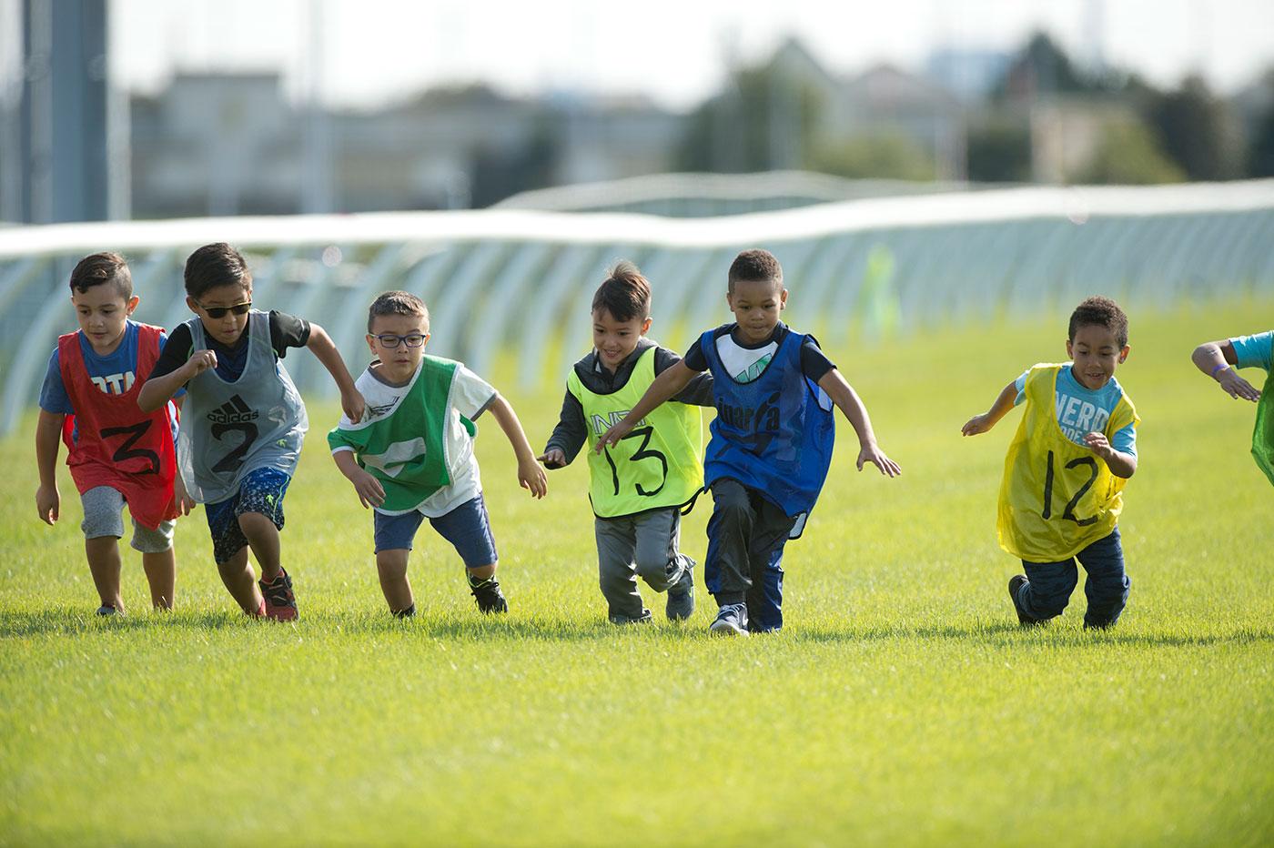 wegcare children running on woodbine turf track