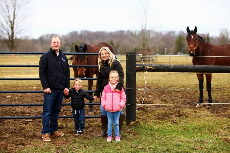 Matt Bax with his wife Ayla, son Tucker and daughter Elliott at the Bax Stables in Campbellville, Ontario.
