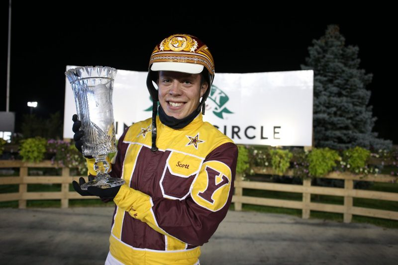 Scott Young poses with a trophy after winning last year's William Wellwood Memorial with On A Streak.