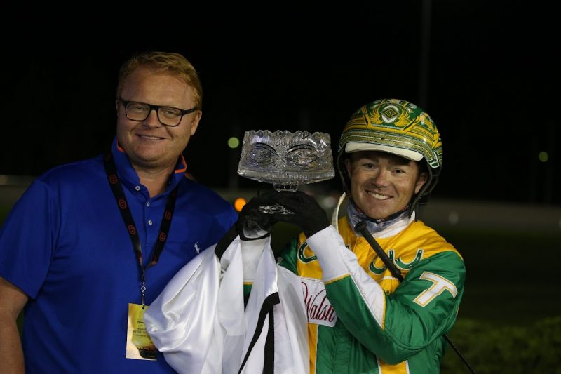 Driver Tim Tetrick poses with the Milton Stakes trophy and Mayor of Milton, Gordon Krantz after winning with Lyons Sentinel. (New Image Media)
