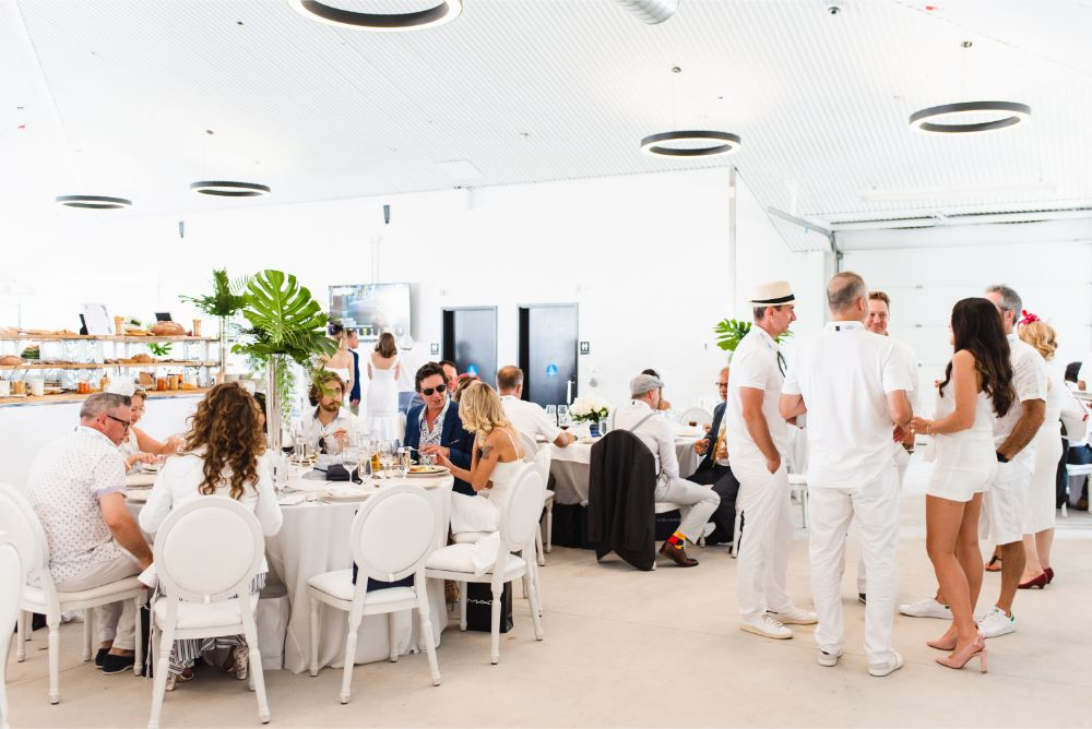 Guests dine at White Party