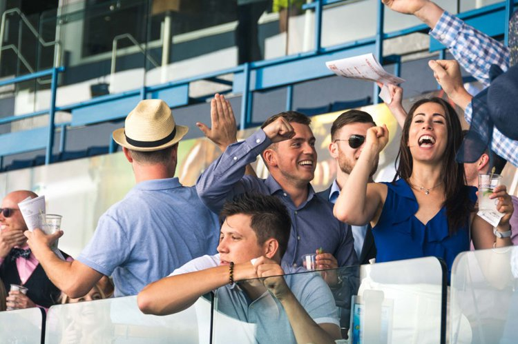 Guests celebrate on Champions Bar & Patio at Woodbine Racetrack