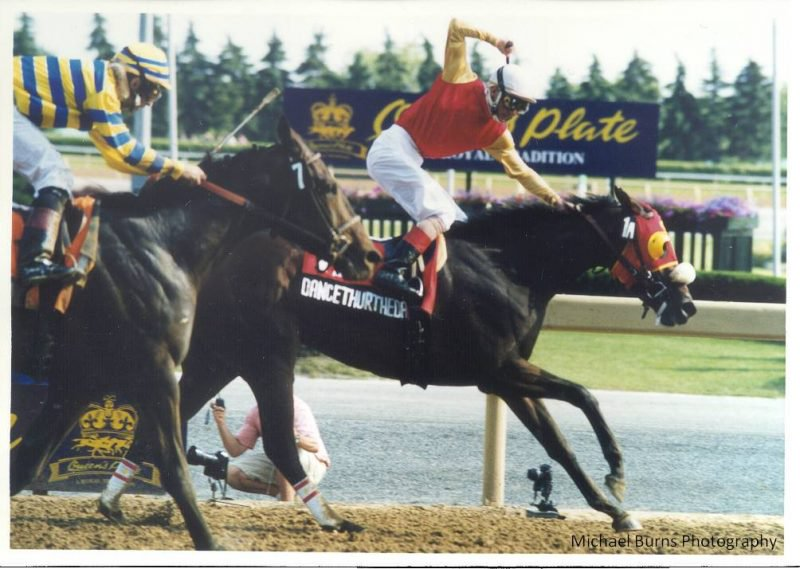 Dancethruthedawn and Gary Boulanger win the Queen's Plate in 2001. Photo by Michael Burns.