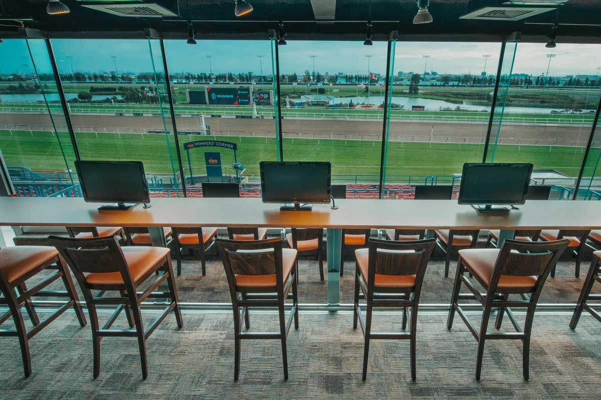 Finish Line O&T Lounge for Owners and Trainers trackside full view with screens