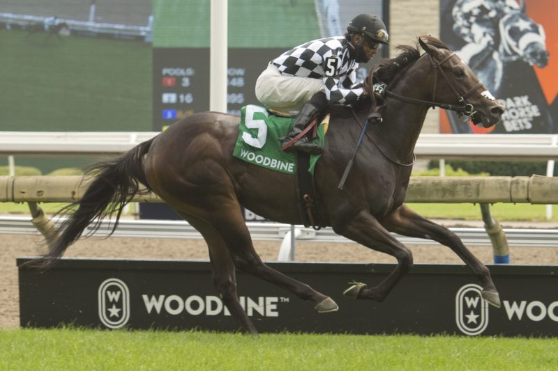 First Empire and Patrick Husbands winning the Soaring Free on August 21.