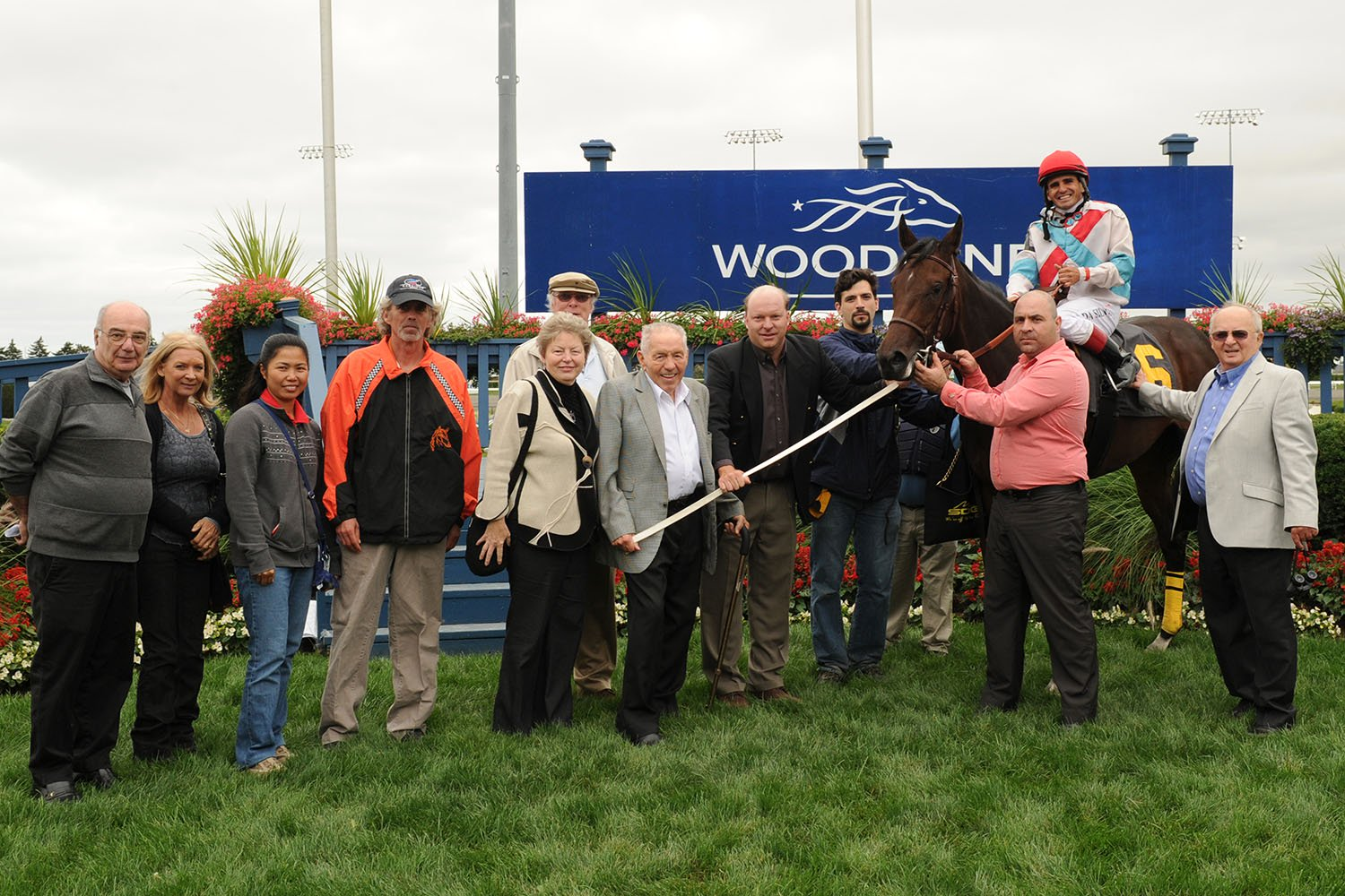 Jim Sabiston (center with grey jacket) in the winner's circle at Woodbine Racetrack with 2011 Muskoka Stakes champion Rose and Shine. (Michael Burns Photo)