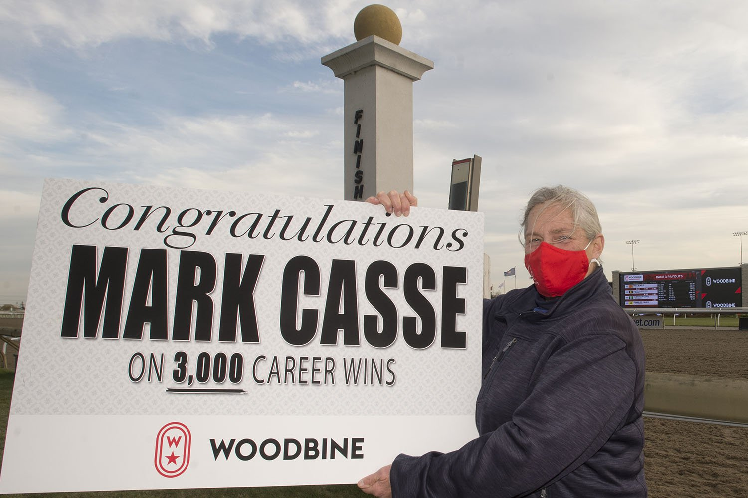 Woodbine congratulates Mark Casse on his 3,000th career win across Canada and the U.S., with a special presentation to his local team, including assistant trainer Nancy Sullivan, on Thursday. (Michael Burns Photo)