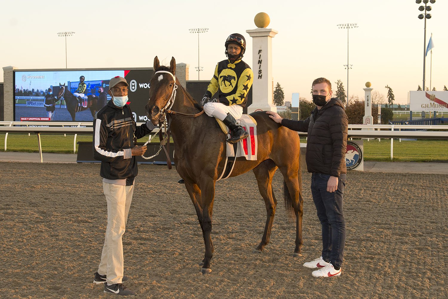 Trainer Cole Bennett (right) in the winner's circle celebrating a special victory by Ms Wicked on November 8 at Woodbine Racetrack. (Michael Burns Photo)