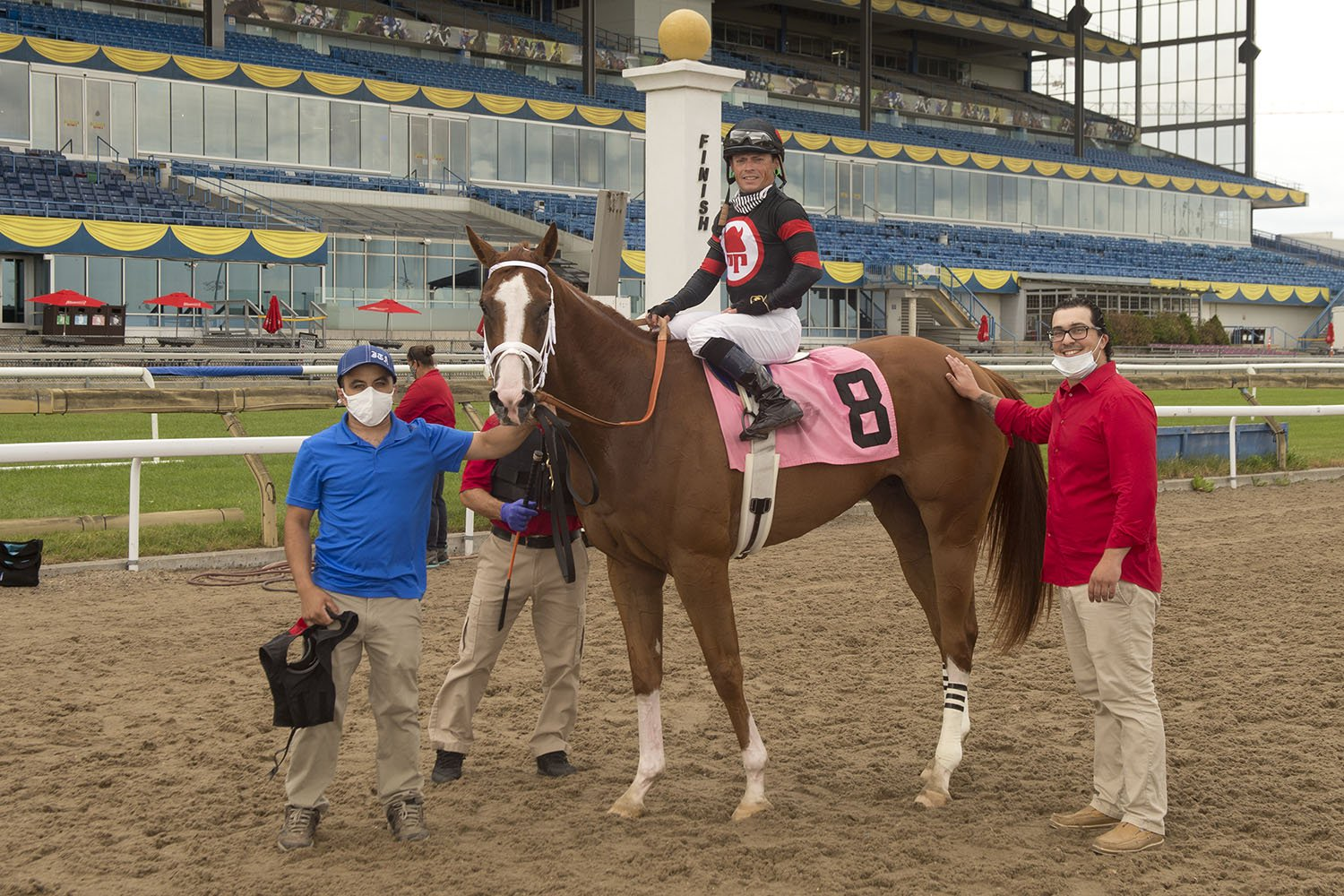 Trainer Jamie Attard (right) in the winner's circle celebrating a special victory by Red Hierarchy on July 12 at Woodbine Racetrack. (Michael Burns Photo)