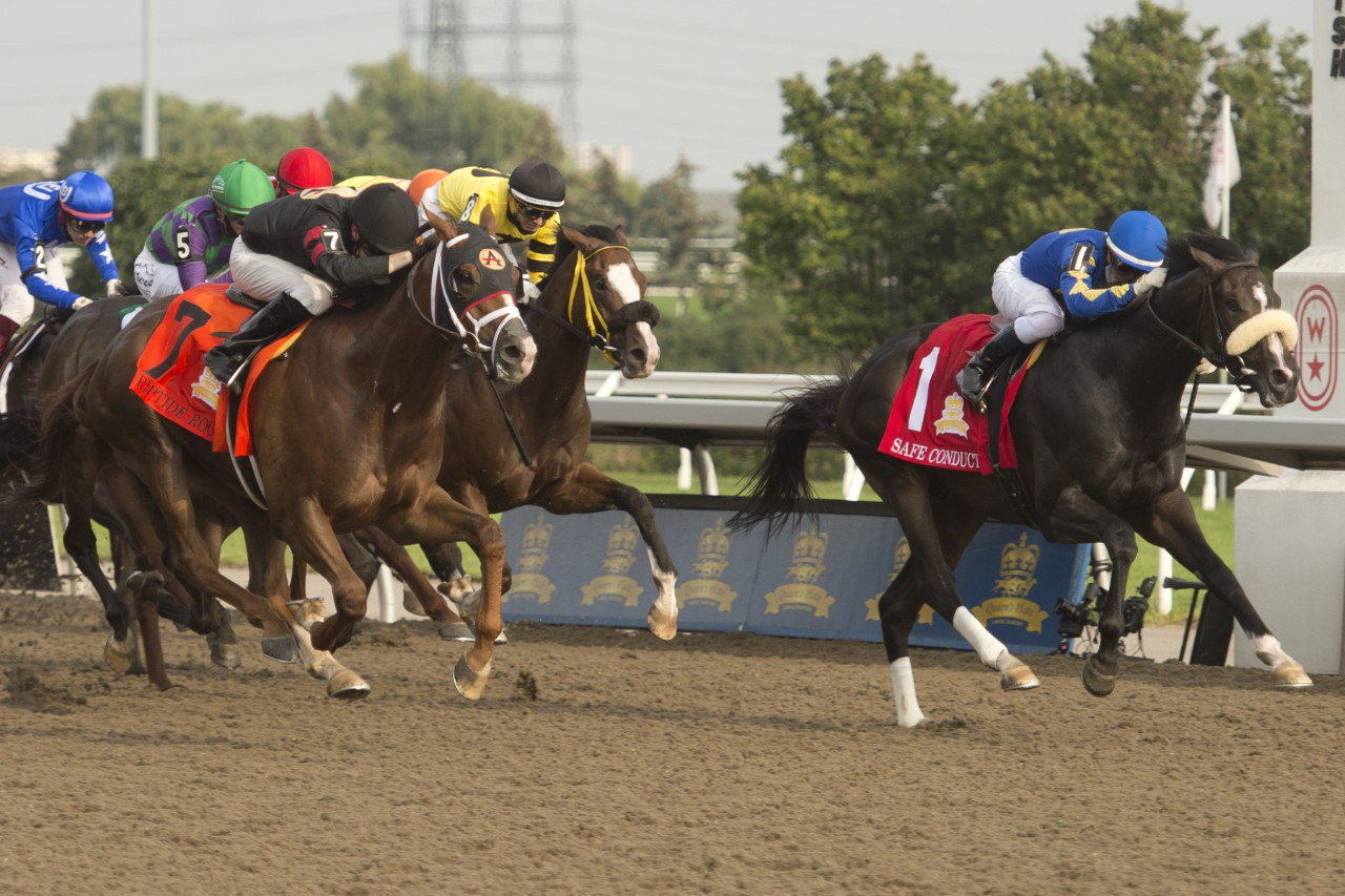 Safe Conduct at the finish line winning the 2021 Queens Plate on Aug 22, 2021 at Woodbine Racetrack