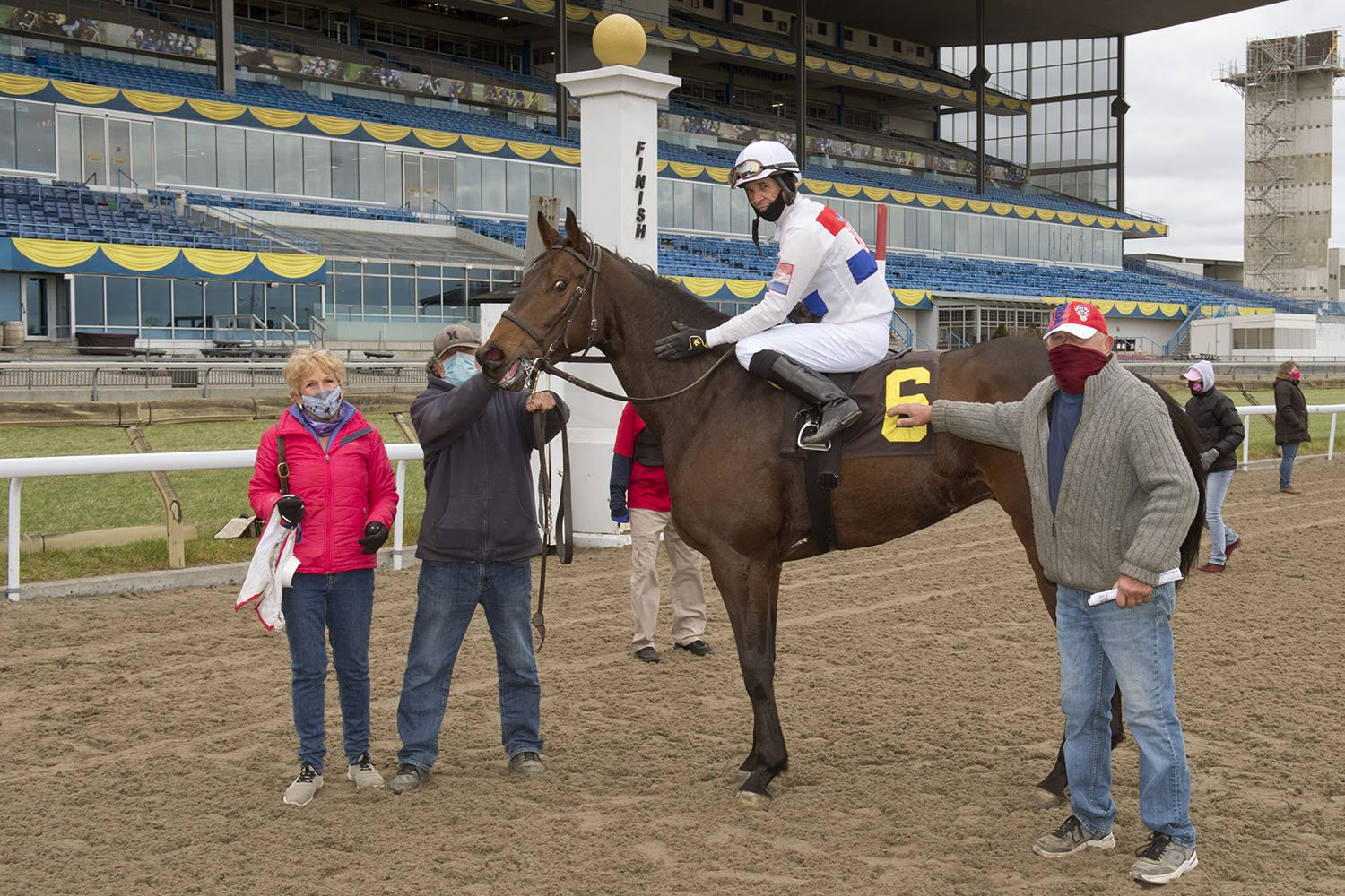 Trainer Zeljko Krcmar (right) in the winner's circle on November 21 celebrating his 16th win of the year with 27-1 longshot Victor's Destiny. (Michael Burns Photo)