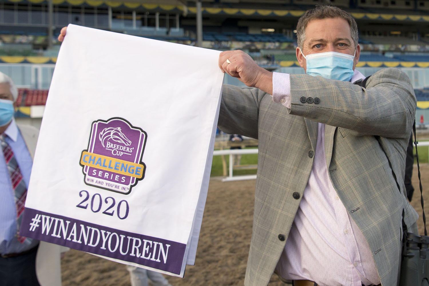 Trainer Kevin Attard shows off Starship Jubilee's Breeders' Cup 'Win And You're In' saddle cloth. (Michael Burns Photo)