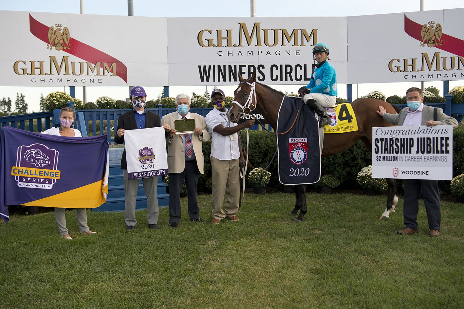 Newly minted double millionairess Starship Jubilee and her connections in the winner's circle at Woodbine after defeating the boys in the Ricoh Woodbine Mile. (Michael Burns Photo)