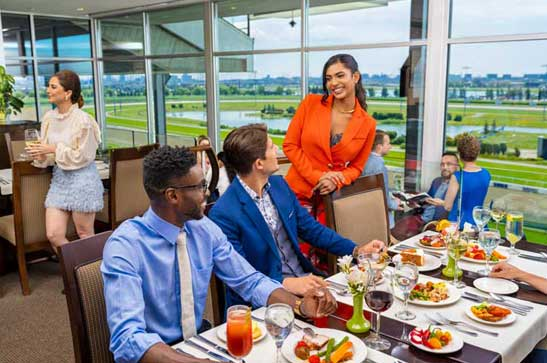 Guests at Woodbine Club Dining Room